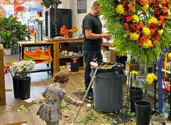 With a little help from family, our floral designers focus on a funeral spray